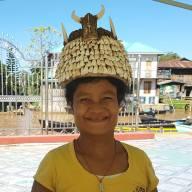 Girl selling teeth helmet at Inle lake