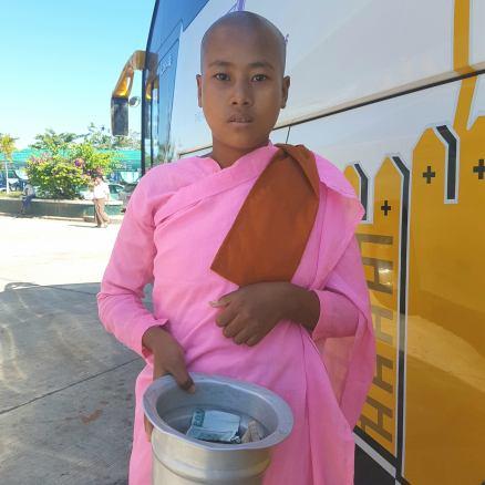 Nun at a bus stop